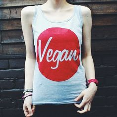 "Vegan emblem Tank Top pre orderModel is wearing a size SmallSmall - Chest: 32""-34""Medium - Chest: 34""-36""Large - Chest: 36""-38""Gildan womans TankRing Spun90% Cotton 10% Polyester This is a pre order item and you will notified to when it will be shipped. If you have any questions or would like an update please to contact us."