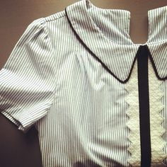 Les Julie Choses. Dapper blouse with black and white detail.
