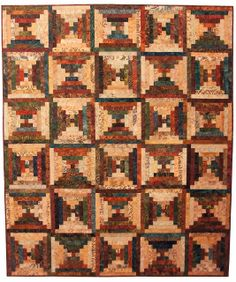 Magnolia Bay Quilts: On the Fly.  Some stages in the creation of this courthouse steps quilt.