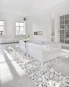Lovely Unique Bathroom Design Ideas Total whiteout -- white rocks, white floors, white walls and smooth surfaces creating the ultimate luxurious feeling. Stone Bathroom, Modern Bathroom, Small Bathroom, Bathroom Ideas, Bathroom Designs, Minimalist Bathroom, Zen Bathroom, Modern Room, Bathroom Storage