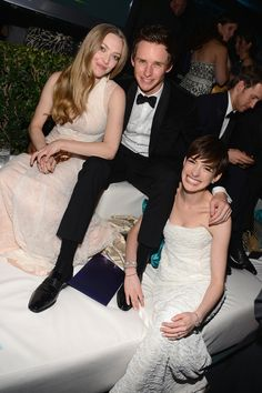 Amanda Seyfried, Redmaynel and Anne Hathaway at a Golden Globes afterparty.