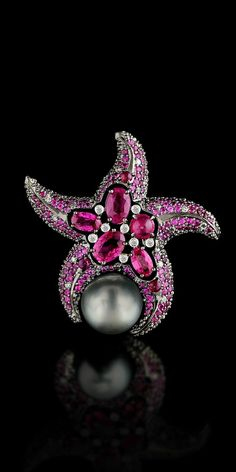 Brooch from the Secrets of the Ocean series by Russian studio of Master Exclusive Jewellery. Pearls, opals, white and red diamonds, various coloured sapphires.