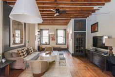 Eclectic living room by PS & Daughters. Note the base board and door trim color.