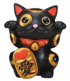 Maneki Neko, the Beckoning Cat. Right paw up for money to come in, left paw up for customers to come in. Both paws up... jackpot! :-)