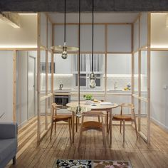 Spanish architecture studio Pauzarq uncovered the original concrete girders of this apartment in Bilbao to map its new broken-plan layout.