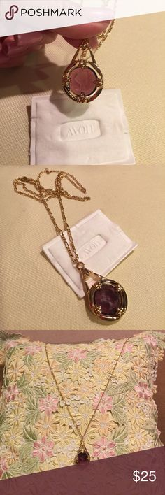AVON CAMEO ANTIQUE MOMENTS INTAGLIO PENDANT  Beautiful Cameo Intaglio Amethyst Colored Pendant necklace on a lovely 24  inches long gold tone chain. Original box included. Box shows wear . Necklace is in mint condition ❤️. Avon Jewelry Necklaces