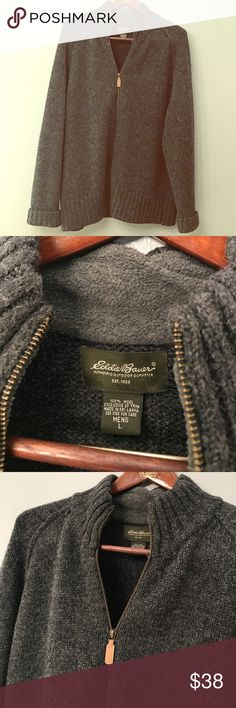 Eddie Bauer Mens L 100% wool zipper sweater jacket 100% wool Eddie Bauer authentic outdoor outfitter men's sweater. Inside below the caller you can see in one of the photos that part of the inside lining is loose for about maybe a little less than an inch it is not noticeable on the outside nor does it affects the zipper. Very warm classy sweater. Eddie Bauer Sweaters Zip Up