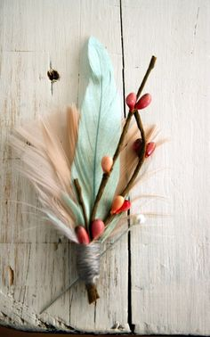 Feather and berry boutonniere.