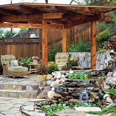 Nestle an outdoor living space into your hillside. Steps to a raised flagstone patio provide a great view of the rest of the garden and the trickling stream provides soothing sounds for relaxation.