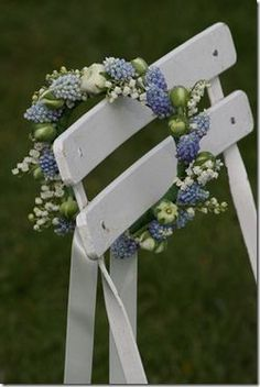 Flower crown created with blue muscari, white ranunculus and lily of the valley.