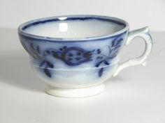 Blue and white saucer with smudged floral pattern; together with three cups and two small plates. c.1830-50