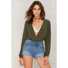 Lauryn Plunging Top (£36) ❤ liked on Polyvore featuring tops, green, plunge-neck tops, plunging neckline tops, low top, plunge top and green top