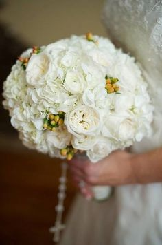 Classic,, elegant bouquet made with white hydrangea, white garden roses and pink hypericum berries. Casie Webb Designs casiewebbdesigns.com Phototgraphy: lindseymichellephotography.com