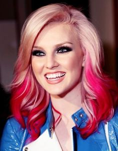 Blonde hair with an Ombre of pink and red. Beautiful!