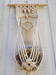 A fun way to display your plants! This modern macrame wall hanging can be hung on a wall or in a window. Hangs on a 12 inch dowel approximately 30 inches from hanger to fringe 5 inch pots or glass bowls will fit perfectly Please visit here for our TRIO and save: