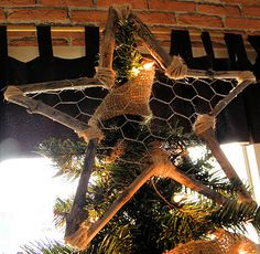 Homemade tree topper out of chicken wire, thin rope and sticks. I like the simplicity of this. Pretty. Maybe I'll try to make one for the front step.