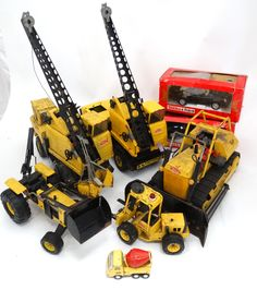 Lot 523: A collection of 8 #Tonka vehicles, to include : A Tonka Polistil #Porsche 911, 1:16 TG, a #Ferrari GTO , 1:16 TG, together with a selection of 1970s Tonka Machinery to include a Mighty Tonka Dozer T-9, a  Tonka #Forklift, , a  Tonka Bucket #Crane , a Tonka bulldozer with #snowplough, a small Tonka cement mixer and a Tonka #tractor. (8)