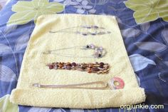 A Simple & Inexpensive Travel Jewelry Organizer : I'm an Organizing Junkie Roll necklaces in a hand towel - so simple!
