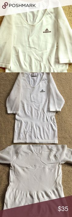 Stella McCartney for Adidas Workout Top Perforated sleeves. Perfectly form fitting exercise top. No built-in bra. No flaws. Good used condition. Adidas by Stella McCartney Tops Tees - Short Sleeve