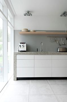 Exterior and Interior House in Beautiful Atmosphere: Minimalist Kitchen Space In Rietveld Bungalow With White Drawers White Cabinets Grey Co. Minimalist Kitchen Design, Contemporary Kitchen, Kitchen Design, Kitchen Renovation, Interior, White Kitchen Cabinets, Kitchen Interior, Kitchen Style, Minimalist Kitchen