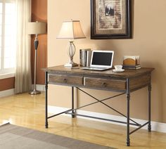 Salvaged Charm. Rustic and bold, the Bedford desk features the natural charm of reclaimed wood. Finished in dark natural pine, this piece has stylish iron legs and classic beveled edges. Two wide drawers provide ample space for storing office necessities, books and collectibles, while a unique X-frame on the back of this desk adds visual interest. Customer assembly required.