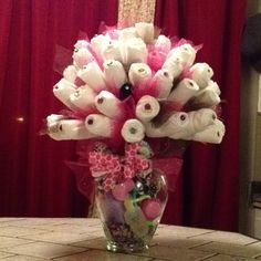 Diaper Bouquet:  Foam ball Wooden skewers 60 diapers + socks, bibs, burp rags... Clear rubber bands  Tulle