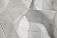 Geometric Textiles Design with tessellating triangle structure using tyvek; fabric manipulation // Lene Schendler