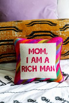 Cher said it best when her mom told her 'she needed to find a rich man'... 'Mom, I am a rich man'. A Furbish exclusive, this piece is hand-embroidered, and backed with luxe pink velvet.