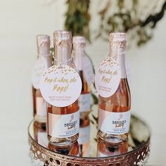 Invite your friends and family to a collective toast upon Baby's arrival with these adorable and chic champagne baby shower favors #popitwhenshepops Baby Shower Tags, Baby Shower Favors Girl, Tea Party Baby Shower, Baby Girl Shower Themes, Boho Baby Shower, Baby Shower Decorations, Baby Shower Gifts, Baby Showers, Champagne Party