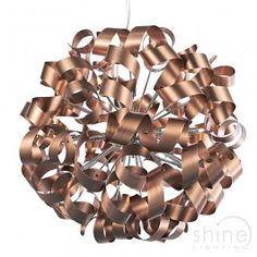 Rawley RAW1264 by Dar Lighting Dar Lighting | Rawley RAW1264 Modern 12 light round pendant ceiling light. Featuring a twisted metal ribbon design.  Finished in brushed satin copper.   12 x 25w G9 Mains Voltage Halogen bulbs (Included)  Height adjustable prior to installation.   Height: 80cm - 250cm  Diam: 80cm £490.00