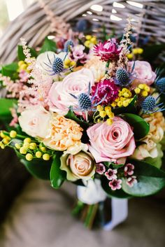 Every colour of the rainbow bridal bouquet by Lola Mai Floral Styling // Photos by Lara Hotz Photography