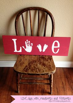 Fabulous DIY Love sign made with hand and footprints - what a cute idea with kids prints!