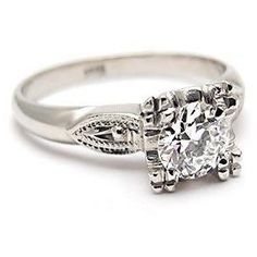the most gorgeous vintage diamond engagement ring I could ever dream up.