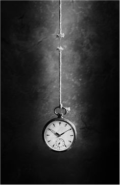 Black and white photography by Victoria Ivanova life like a thread. Really love the use of lighting with this image as well as the many connotations within this image. Black N White, Black And White Pictures, White Art, Photocollage, Conceptual Photography, Time Photography, Pinterest Photography, Watches Photography, White Image