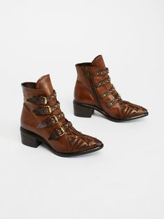 Eastern State Ankle Boot | Luxe leather ankle boots featuring multiple buckers with metal stud detailing. * Faux calf-hair animal print accent * Inside zip closure * Stacked heel * Padded footbed