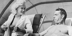 Marilyn Monroe laughs as Joe DiMaggio sticks out his tongue gagging it up for photographers as the former Mr. couple relaxed in a cabana here March Marilyn is here for a short vacation. Get premium, high resolution news photos at Getty Images