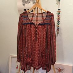 free people beaded tunic, Sz. M Gently worn, almost perfect free people tribal print tunic with beading in size M. It's sheer and great over a bodycon slip dress or with a tank and jeans. There is a little run by the pocket please check last photo. Free People Tops Tunics