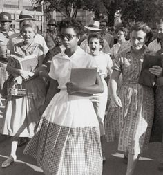 This is another iconic image of the 50′s segregation period. Elizabeth Eckford is one of the African American students known as the Little Rock Nine. On September 4, 1957, she and eight other African American students attempted to enter Little Rock Central High School, which had previously only accepted white students.