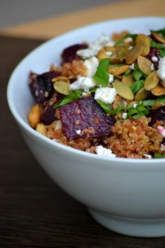 Roasted Beet and Quinoa Salad  1 lb beets   2 tbs olive oil  pinch of sea salt   2 cups quiona prepared 1/4 cup diced red onion 1 clove minced garlic 4-5 fresh basil leaves, chopped 1/4 cup pumpkin seeds 1/2 cup feta cheese Balsamic reduction for serving (recipe follows)