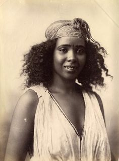 Algerian woman, 1870's; How can anyone have looked at a woman like this and thought she was an animal? She's beautiful! But in the 1870's, she would have been a slave....and on a lighter note...she rockin that twist out...lol