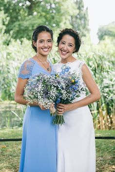 Bridesmaid in blue, bride in Charlie Bear | A pretty blue summer Stoke Newington wedding. Bride wears dress by Charlie Brear. Photography by Caro Photo