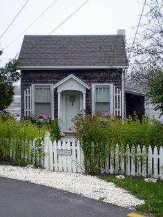 New England shingle style tiny cottage. Elements of Style Blog | Tiny, Cozy Cottages. | http://www.elementsofstyleblog.com