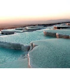 Amazing place in Pamukkale, Turkey  The Pamukkale travertine pools are a strange formation caused by thermal springs that have been going forever.  The mineral composition of the water creates white travertine pools.