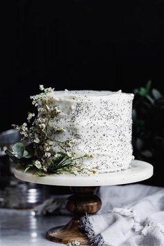 A luxurious lemon poppy seed cake with lemon cream cheese frosting. A luxurious lemon poppy seed cake with lemon cream cheese frosting. Desserts Potluck, Slow Cooker Desserts, Potluck Dinner, Naked Wedding Cake, Wedding Cake Rustic, White Wedding Cakes, Rustic Cake, Cupcakes, Cupcake Cakes