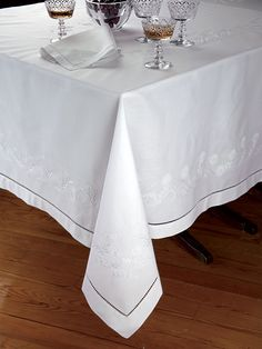 Duchess - Luxury Table Cloths - Looking very like an ancestral heirloom, 100% Italian linen is hand-embroidered and hemstitched with such artistry and skill, these magnificent tablecloths, napkins and cocktail napkins may well become heirlooms of tomorrow
