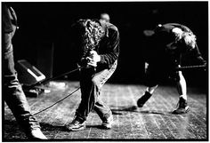 """Brixton Academy, London. 1993. """"There's graffiti from The Clash in the dressing room. It was really cool to be there. I just started shooting. Anytime I can shoot a different perspective than what the audience has ... It's really intimate."""" — L.M."""
