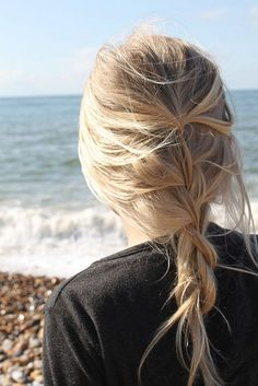 A loose braid keeps your hair tamed for a day at the beach even if you forgot a hair tie.
