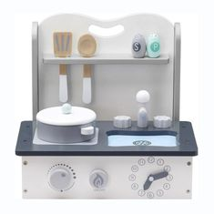 This lovely Mini Table-top Toy Kitchen from Kid's Concept, will keep your little one busy for hours.