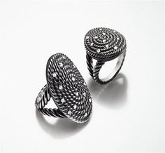 The Cable Coil collection contrasts the brilliance of diamonds with the  artisanal quality of oxidized silver coils.