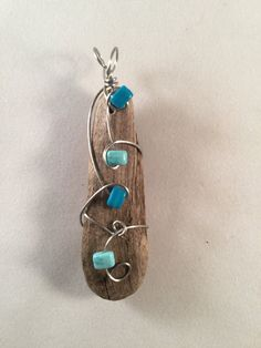 Driftwood wire wrapped pendant with Blue Beads by ParadiseBreezJewelry on Etsy